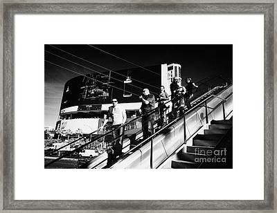 people riding on escalators on Las Vegas boulevard Nevada USA Framed Print by Joe Fox