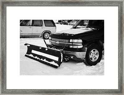 pickup truck fitted with snowplow in car park Saskatoon Saskatchewan Canada Framed Print by Joe Fox