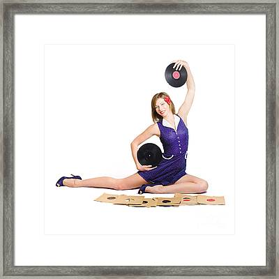 Pin-up Woman Balancing Sound With Record Music Framed Print by Jorgo Photography - Wall Art Gallery