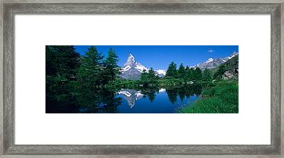 Reflection Of A Snow Covered Mountain Framed Print by Panoramic Images