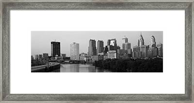 River Passing Through A City Framed Print by Panoramic Images