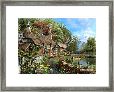 Riverside Home In Bloom Framed Print by Dominic Davison