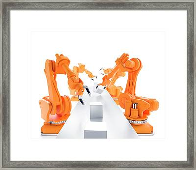 Robots On Production Line Framed Print by Andrzej Wojcicki