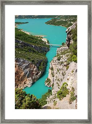 Rocky Cliffs And Turquoise Water Framed Print by Brian Jannsen