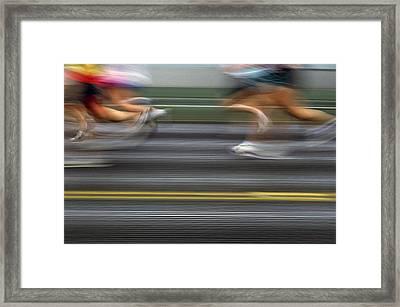 Runners Blurred Framed Print by Jim Corwin