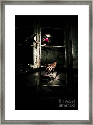 Scary Clown Clawing Window Framed Print by Jorgo Photography - Wall Art Gallery