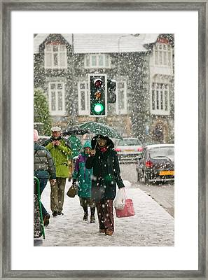 Shoppers Trudging Through Snow Framed Print by Ashley Cooper