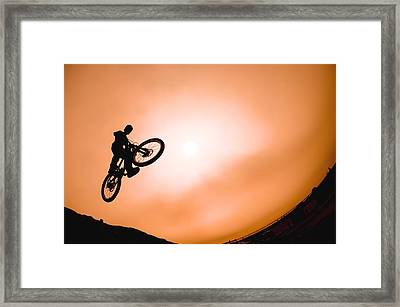 Silhouette Of Stunt Cyclist Framed Print by Corey Hochachka