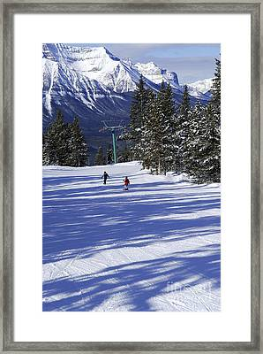 Skiing In Mountains Framed Print by Elena Elisseeva