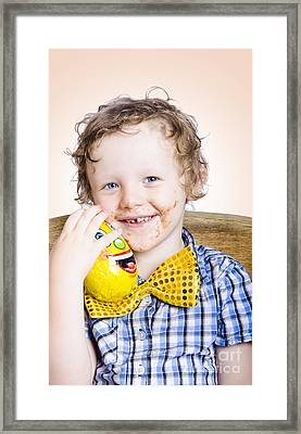 Smiling Happy Kid Holding Easter Egg Gift Framed Print by Jorgo Photography - Wall Art Gallery