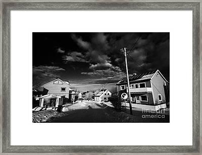 Snow Covered Street Of Traditional Wooden Houses In Kirkenes Finnmark Norway Europe Framed Print by Joe Fox