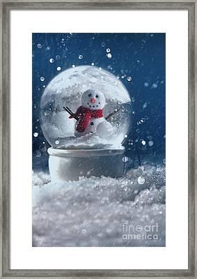 Snow Globe In A Snowy Winter Scene Framed Print by Sandra Cunningham