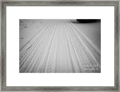 snowmobile tracks in the snow Kamsack Saskatchewan Canada Framed Print by Joe Fox