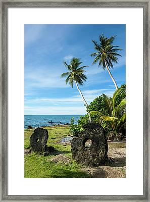 Stone Money On The Island Of Yap Framed Print by Michael Runkel
