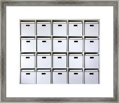 Storage Boxes On Shelves Framed Print by Wladimir Bulgar
