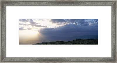 Sunbeams Radiating Through Clouds Framed Print by Panoramic Images