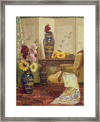 Sunflowers And Hollyhocks Framed Print by Kate Hayllar