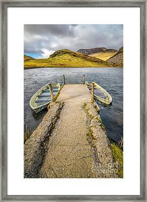 Sunken Boats Framed Print by Adrian Evans