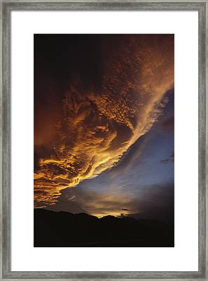 Sunset On Storm Clouds Near Mt Cook Framed Print by Ian Whitehouse