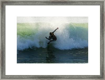 Surfer Catching A Wave Framed Print by Ben Welsh