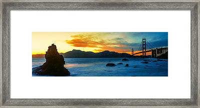 Suspension Bridge Across A Bay At Dusk Framed Print by Panoramic Images