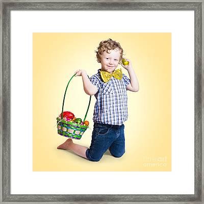 Sweet Little Child Holding Easter Egg Basket Framed Print by Jorgo Photography - Wall Art Gallery