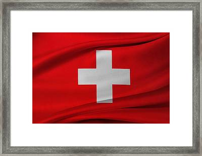 Swiss Flag Framed Print by Les Cunliffe