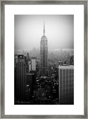 The Empire State Building In New York City Framed Print by Ilker Goksen