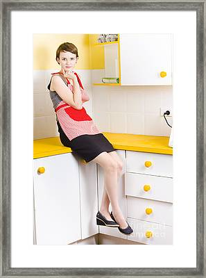 Thoughtful Woman In Kitchen Framed Print by Jorgo Photography - Wall Art Gallery