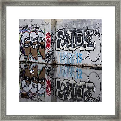 Three Skulls Graffiti Framed Print by Carol Leigh
