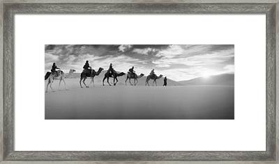 Tourists Riding Camels Framed Print by Panoramic Images
