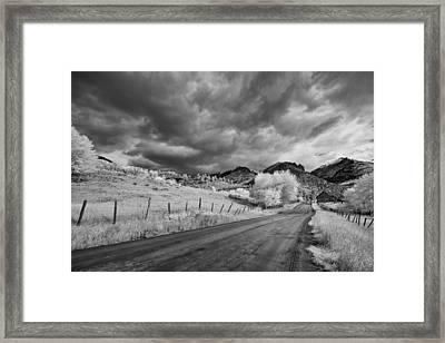 Traveling Down Framed Print by Jon Glaser