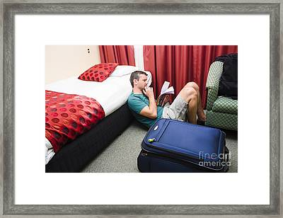 Travelling Man Holding Travel Itinerary Framed Print by Jorgo Photography - Wall Art Gallery