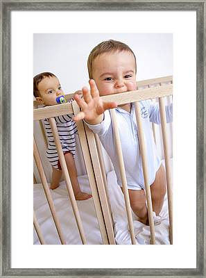 Twin Baby Boys In Their Cots Framed Print by Aj Photo