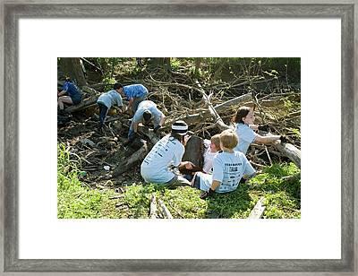 Volunteers Clearing Logs Framed Print by Jim West