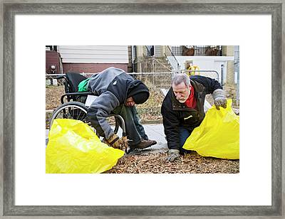 Volunteers Clearing Park Litter Framed Print by Jim West