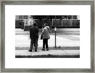 Waiting For The Bus Framed Print by John Rizzuto