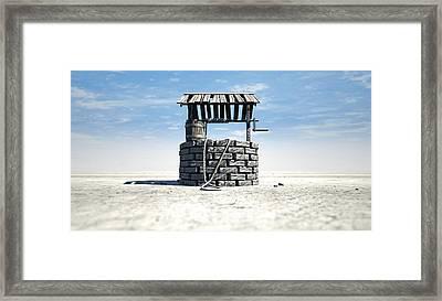 Wishing Well With Wooden Bucket On A Barren Landscape Framed Print by Allan Swart