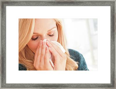 Woman Blowing Nose With Tissue Framed Print by Ian Hooton