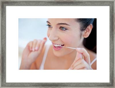 Woman Flossing Teeth Framed Print by Ian Hooton
