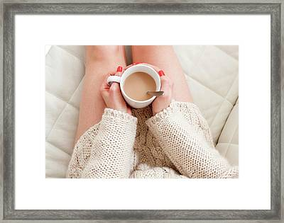 Woman Holding Coffee Framed Print by Ian Hooton