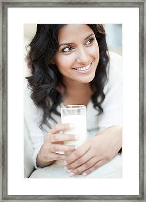Woman Holding Milk Framed Print by Ian Hooton