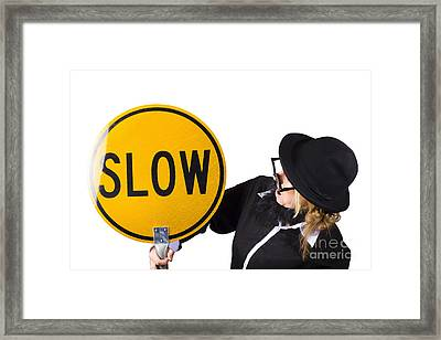 Woman In Black Holding Yellow Slow Sign Framed Print by Jorgo Photography - Wall Art Gallery