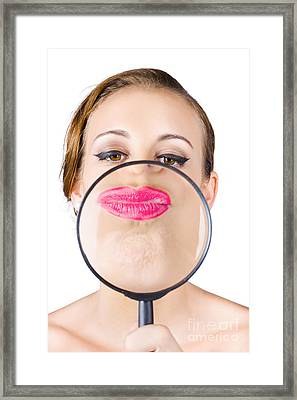 Woman Kissing Magnifying Glass Framed Print by Jorgo Photography - Wall Art Gallery