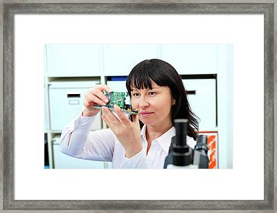 Woman Making A Micro Processor Framed Print by Wladimir Bulgar