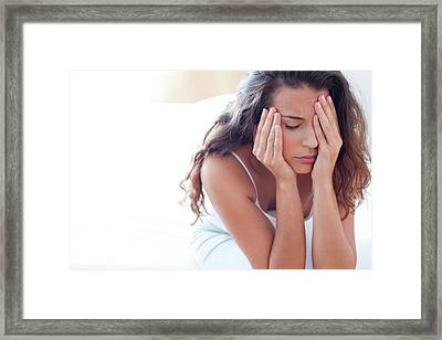Woman On Bed In Pain Framed Print by Ian Hooton