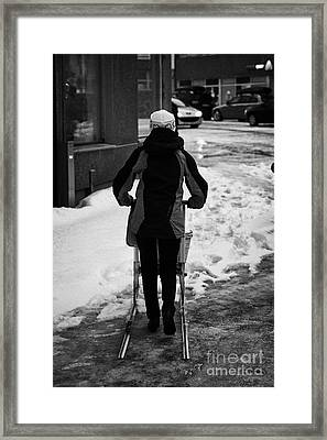 woman pushing kick sled out shopping on ice covered storgata main shopping street Honningsvag finnma Framed Print by Joe Fox