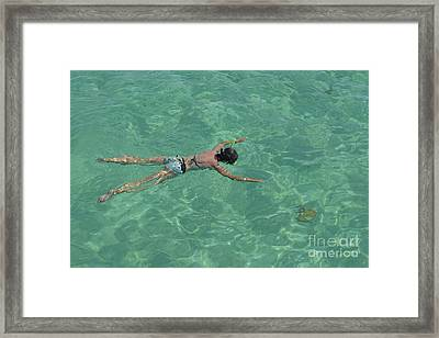Woman Snorkeling By Turquoise Sea Framed Print by Sami Sarkis