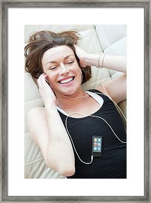 Woman Wearing Earphones Framed Print by Ian Hooton