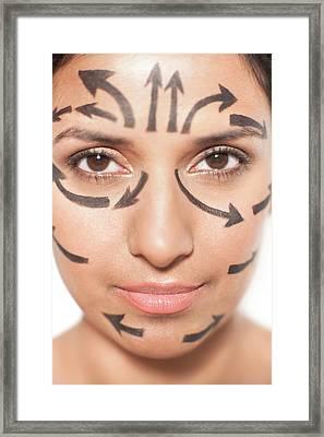 Woman With Arrows On Face Framed Print by Ian Hooton